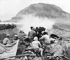 37mm Gun fires against cave positions at Iwo Jima. Cave fighting was intense