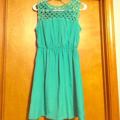 Margo & Sebastian Turquoise Dress I love this dress. Super cute and super functional. Has front pockets. Turquoise color. Gently worn but in great condition. Size medium. Smoke free home. Margo & Sebastian Dresses