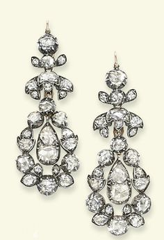 A PAIR OF GEORGE III DIAMOND EAR PENDANTS   Each suspending a two-stone rose-cut diamond drop within a rose-cut diamond pear-shaped surround to the foliate surmount and original hook fitting, in closed back silver and gold setting, surround detachable, circa 1800, 6.0 cm long