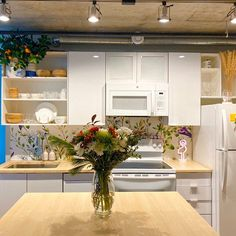 A beautiful soft floral decoration, perfect idea to refresh kitchen for spring home decor. Spring 2020 decor looks fantastic. A removable wall mural  Watercolor Wild Flower is humid proof and works great in every modern kitchen #kitchendecor #kitchenideas #springkitchen #springdecor #homeideas #homedesign #decorideas #decorating #peelandstick #removable #reusable #floralprint #flowers #springfloral