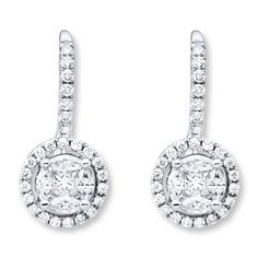 Princess-cut diamonds nestled by marquise diamonds form the brilliant centers of these chic drop earrings for her. Round diamonds encircle the centers and line the bales to complete the look. Crafted of 14K white gold, the earrings have a total diamond weight of 3/4 carat, and secure with euro-wire backs. Diamond Total Carat Weight may range from .69 - .82 carats.