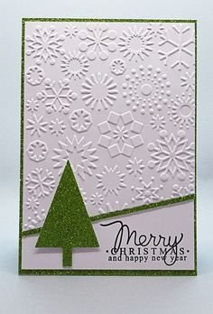 handmade Christmas card from My Card Attic ... white with mats and die cut triangle tree in green glitter paper .. luv how she used embossing folder texture as the background ...