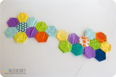 Very cool way to make a hexagon quilt