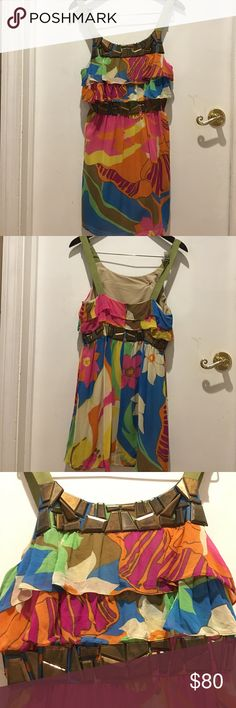 Women's Multi-Color Dress beaded details ❤️SILK❤️ Women's Multi-Color Dress❤️PURE SILK❤️ with bronzed beaded details. Tiny flaw as seen in the fabric. Can hardly be seen. U would really have to look. Semi sheer fabric with lining. Ribbon strap. Zipper in back. Flattering ruffled front/back top. Such a fun/bright dress...perfect for spring/summer. Even the fall with so stockings. I picture this with heels/wedges/even boots & jean jacket. 😍 bought in NY this dress is so pretty 🎉Bundle…