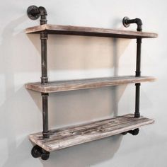 A rustic pipe and wooden bookshelf that is not only practical but looks great too!