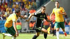 Australia's defender Ryan McGowan (L) vies with Spain's forward Fernando Torres (R).