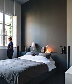 Wenes and Lens conceptualized a gradation of white to gray hues for the walls of the 1,500-square-foot gallery into the 4,000-square-foot home, culminating in a deep gray for the master bedroom. The room is reserved for meaningful pieces from the couple's collection, such as a figure they found at a market in Beijing and lamps by artists Wenes represents.    Photo by Tim Van de Velde.