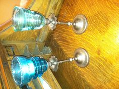 Made these today! Thrift store candle sticks... Spray paint... Super glue... And old insulators.