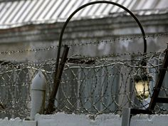 A barbed wire is seen over a fence of the Lefortovo prison in Moscow