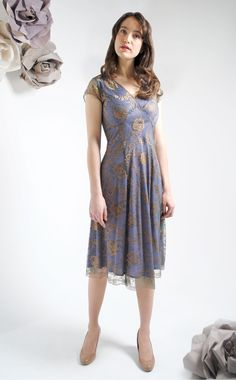 The Kristen Bronze/Sugar Lace Dress by Nancy Mac. The ideal special occasion dress made from hand finished reef lace with a delicate scalloped edged hem and contrast teal lining. Shop the collection at www.lux-fix.com