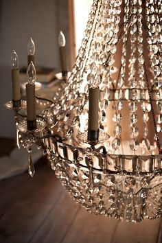 Sunlight glistens through each hand-cut emerald and graduated oval crystal of the Evalina Chandelier