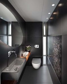 16 Almost Pure Black Bathroom Design Ideas : Small Bathroom With Black Wall Color And Rectangle Sink With Oval Mirror Design