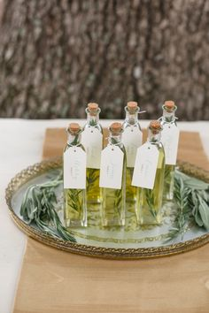 Another winner from Wedding Chicks:infused oil escort cards. This whole photo shoot is stunning!