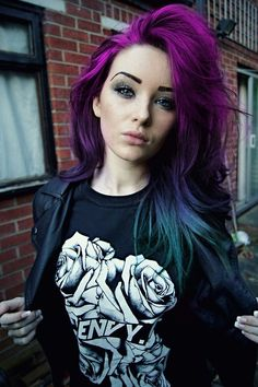purple pink to blue green ombre. I would look teriible if my hair was like this but it looks good on her