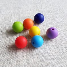 This listing is for a set of 7 beads. Diameter of each bead is 12 mm (hole - 2 mm). I hope that rainbow selection of colors will perfectly suit your handmade projects.  All our silicone beads and shapes in our shop have the following characteristics: - 100% non toxic; - BPA free; - Easy to clean (warm water with soap); - PVC free; - Lead free; - Cadmium free.  ***************************************** Shipping and handling: - All orders will be shipped from Winnipeg (Canada); - All paid…