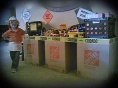 Construction Birthday Party Play Area using Home Depot boxes, caution tape and peg board. Craft & Crown