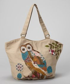 Detailed patchwork and a wise old owl embellish this one-of-a-kind tote. Zipping smartly at the top and featuring a classic cream shade with a charming look, the haute handbag will add spark to the task of stowing essentials. Inside, both a zip and slip pocket organize accoutrements with pizazz.