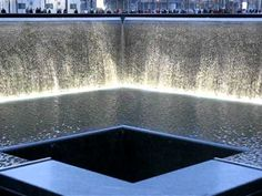 Ground Zero Memorial  It is located at the site of the former World Trade Center complex, occupies approximately half of the 16-acre site, and features two enormous waterfalls and reflecting pools, each about an acre in size, set within the footprints of the original Twin Towers.