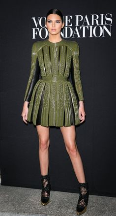 Pin for Later: 25 Sexy Kardashian Looks That Will Convince You to Shop Balmain x H&M  Kendall channeled her inner warrior in a tough army green minidress during Haute Couture Fashion Week in 2014.