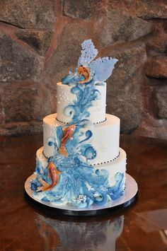 http://sweetcheeksbaking.com/wp-content/gallery/wedding-cakes/koi-cake-mt-woodson-castle.jpg