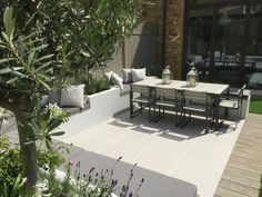 Harrington Porter used Urban Grey Porcelain Paving to create this crisp, contemporary exterior dining area.