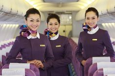 Xiamen Airlines unveiled its new cabin crew uniforms on August 31, 2014 when its first Boeing 787 Dreamliner arrived in Xiamen. The latest uniforms will be quite different compared with the current purple uniforms from the colours to the design. The new design will make the attendants look more international, which matches the SkyTeam airline's pace of internationalization. Aviation News, Civil Aviation, Alaska Airlines Flight Attendant, Boeing 787 Dreamliner, Airline Uniforms, Airline Flights, Xiamen, Cabin Crew, Attendance