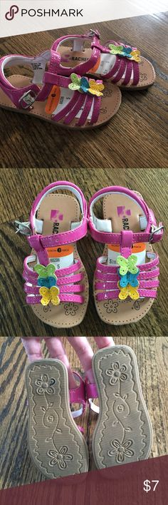 🎀New listing🎀Baby Butterfly sandals These sweet little sandals are bright pink patent with yellow, blue & green butterflies.  They were only worn a few times and still have the tags affixed.   There is minimal wear to the sole but slight scuffing at the toe.  Size 5. Shoes Baby & Walker