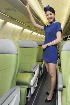 To the pretty Japanese flight attendant, who softly spoke to him and persuaded him to give up his attempt to hijack her flight. He hands over his weapon to her, happy to become her prisoner. Airline Attendant, Flight Attendant, Airline Uniforms, Cabin Crew, Beautiful Asian Girls, Sexy Legs, Asian Woman, Mini Skirts, Short Skirts