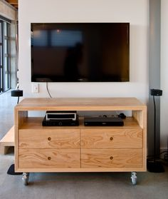 Solid Ash combines well with the chunky castors makeing this TV cabinet moveable between rooms and keeping with the industrial feel of the house