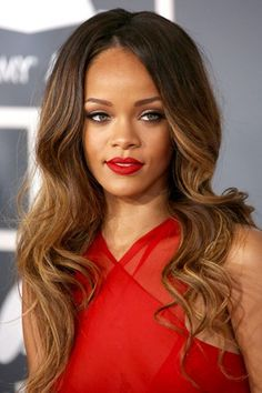 Grammy Awards, February 2013    Rihanna opted for a classic make-up look of red lips, neat brows and black-lined eyes. Her hair was styled in glamorous ombre curls.
