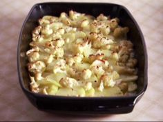 Get Claire Robinson's Golden Potato and Cauliflower Gratin Recipe from Food Network