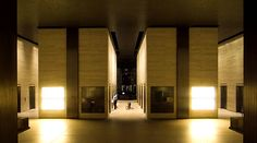 Mies van der Rohe's Seagram Building made of bronze and glass glows from within.