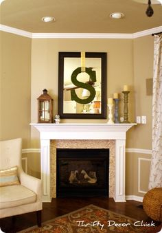 """This is my inspiration for how I want my fireplace/mantel to look.  (except I will have a """"B"""" instead of an """"S"""")  Pretty much the only thing I need is the mirror."""