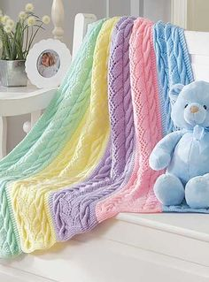Knitting Pattern for Striped Cables Baby Blanket - #ad Cable and lace rainbow blanket knit in sections and seamed. One of 9 patterns in Dreamy Baby Wraps available in digital download or paperback | See more pics at LeisureArts.com http://www.shareasale.com/r.cfm?u=1112880&b=146498&m=19565&afftrack=&urllink=www.leisurearts.com/knitting/afghans-and-blankets/dreamy-baby-wraps-1.html