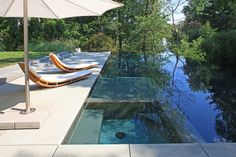 Marvelous Infinity Edge trend Dc Metro Modern Pool Remodeling ideas with aquascape blue outdoor chaise longue chaise lounge concrete paving construction of swimming pool Custom