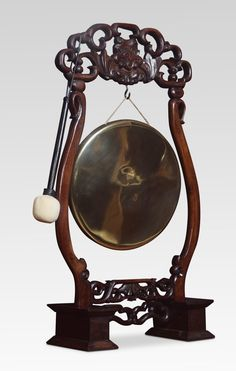 Chinese hardwood framed dinner gong, the frame carved with scrolls supporting the original brass gong.Together with beater. Antiques Atlas #antiquegong #dinnergong #chinesegong Antique Chinese Furniture, Get Directions, Hardwood, Carving, Victorian, Brass, Dinner, Mirror, Antiques