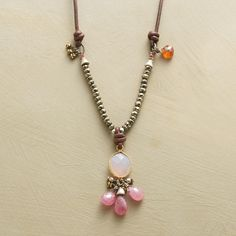 """TICKLED PINK NECKLACE--A pink chalcedony, framed in 24kt goldplate, with pink sapphire briolettes hanging below lends a blush of color to a leather necklace shining with pyrite, brass and a single garnet. Sterling silver lobster clasp. Exclusive. 17-1/2"""" to 18 1/2""""L."""