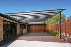 Outdoor pergola designs and other building structures require coverings to provide shelter against harsh weather. Outdoor pergola is the best option for sunbath and use of plexiglas clear roof panels save you from harmful UV rays and showers sunlight Pergola Carport, Steel Pergola, Building A Pergola, Pergola Canopy, Pergola With Roof, Cheap Pergola, Covered Pergola, Outdoor Pergola, Pergola Shade