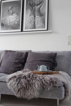 Cool Scandinavian inspired living room with a grey velvet sofa |black and white photo art | beni ourain style rug | IKEA Söderhamn sofa with a Bemz cover in Zinc Grey Zaragoza Vintage Velvet