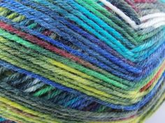 Artyarn sockyarn turquoise emerald lime yellow dyed in colours after painting silver spiral of Hundertwasser Opal 1433 selfstriping knitting by PurpleValleyDesign on Etsy