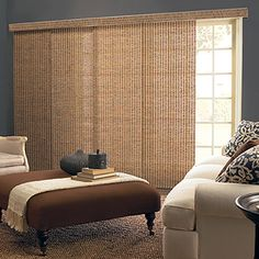 I love bamboo panel curtains (not pictured) and bamboo panel track blinds (pictured here). Not only are they energy efficient and eco-friendly, I think they would stand up to my curious cats much better than standard curtains do. :-) Want 'em.