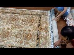 Packing handmade silk rugs for our customer from USA