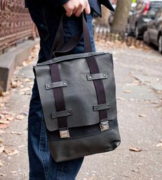 Utilitarian in all black canvas and leather, this compact backpack is a durable and practical bag for everyday use. The flat main compartment features an integrated sleeve for your laptop, with additional space in the main body for a journal, pencil case and your latest read.