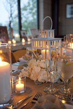 Ooh I love the light-colored lanterns & low flowers...pretty, rustic & simple.