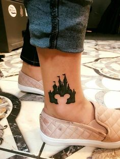 Magical Disney Tattoo Ideas & Inspiration – Brighter Craft 100 magical Disney tattoo ideas for every Disney fanatic. Tattoos last forever, but so does the love for Disney. Movies, charcters, quotes, discover here. Mickey Tattoo, Disney Tattoos Mickey, Disney Mickey, Disney Mouse, Disney Magic, Minnie Mouse, Disney Tattoos Klein, Disney Tattoos Small, Small Tattoos