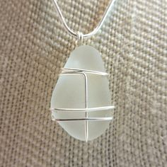 Frosted White Sea Glass Pendant Wrapped in by SilverandSeaJewelry