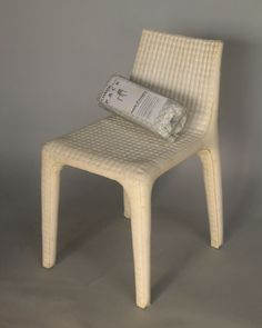 'pack chair' by françois azambourg - designed with the intention of selling it via mail order, the chair is fabricated with an internal airtight polyester cloth pouch and a double lining that contains a two-part  liquid polyurethane foam. activating a switch on the side of the flat chair, the user can start the release of the material, causing it to combust and fill the inside.