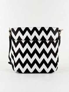 $38.00 - Designer inspired fashion satchel - Chevron print design crossbody bag - Faux leather - Top zipper closure - Adjustable shoulder strap - Size - 10.5' X 10' X 2'