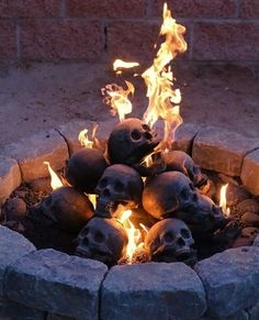 Human Skull Fire Pit Logs. Now these are a conversation starter: Imitation human skull fireplace logs that are made with lava granules. Watch the flames shoot through the skulls, creating a weird yet ambient glow to your fire pit or fireplace.