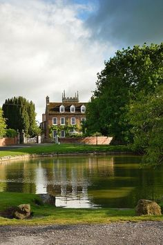 A village green; a duck pond; a Georgian rectory; and a church tower beyond. Picture perfect.